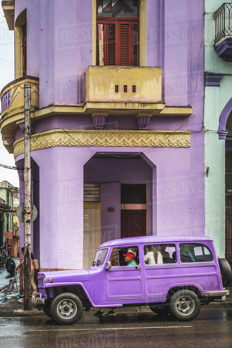 Pink building and pink vintage car in La Habana (Havana), Cuba, West Indies, Caribbean, Central America Royalty-free stock photo