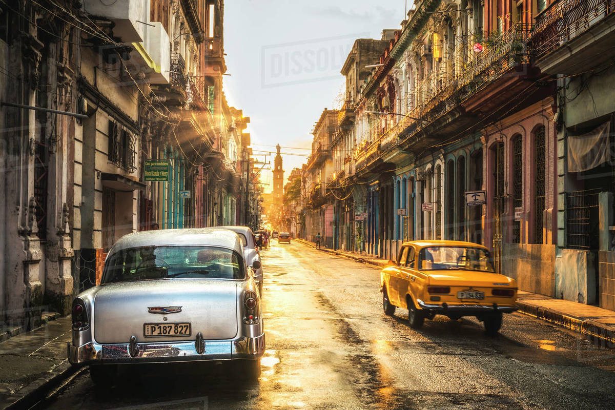 American and Russian vintage cars at sunset, La Habana (Havana), Cuba, West Indies, Caribbean, Central America Royalty-free stock photo