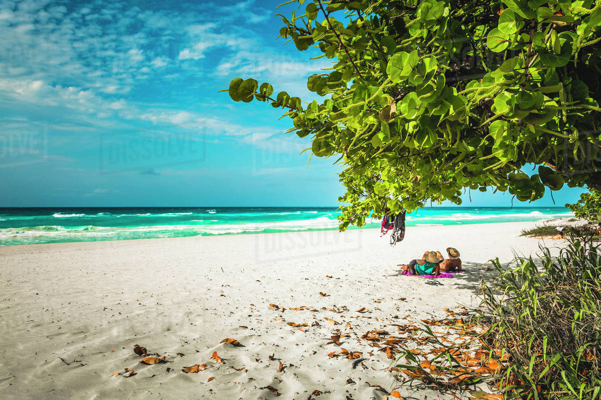 Tourists looking into the sea from Varadero beach, Hicacos Peninsula, Matanzas Province, Cuba, West Indies, Central America Royalty-free stock photo