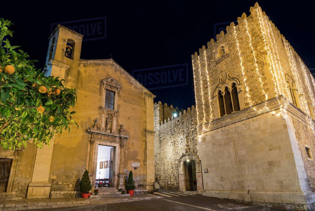Illuminated Santa Caterina Church and Corvaja Palace at night, Taormina, Sicily, Italy, Europe Royalty-free stock photo