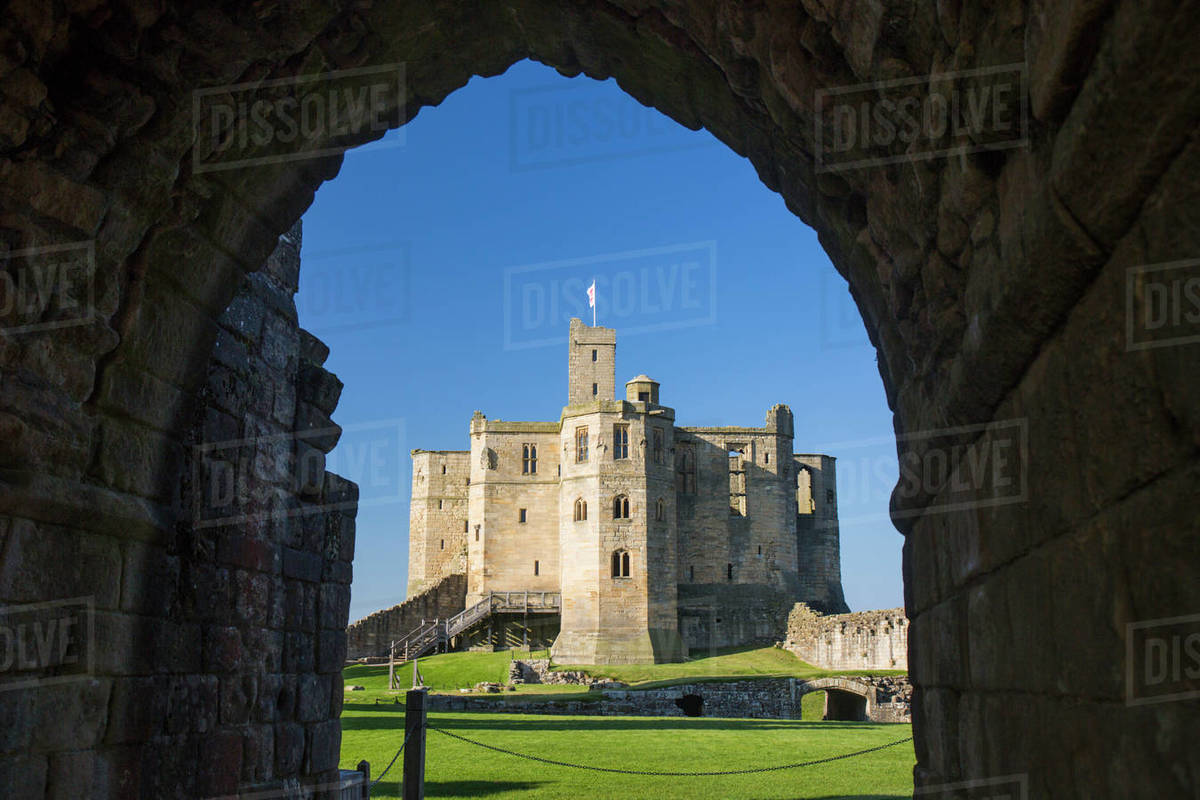 View through arch across lawns to the Great Tower of Warkworth Castle, Warkworth, Northumberland, England, United Kingdom, Europe Rights-managed stock photo