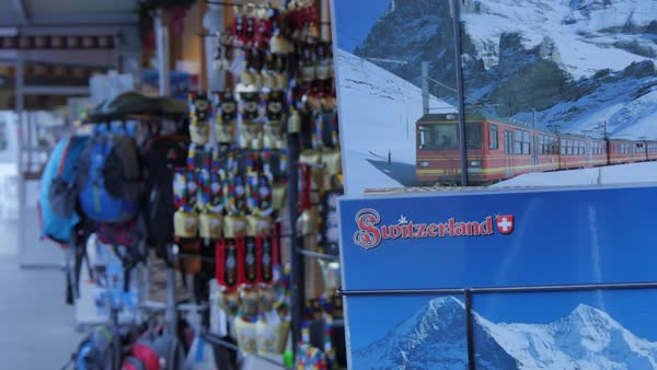 Souvenir Swiss cow bells and calendars on the main street, Grindelwald, Jungfrau region, Bernese Oberland, Swiss Alps, Switzerland, Europe Rights-managed stock video
