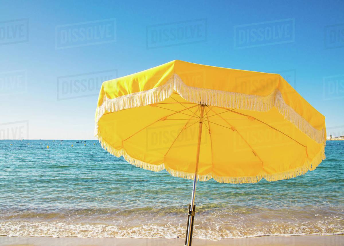 Giant Yellow Beach Umbrella Next To The Ocean Against A Blue Sky In Juan Les Pins Cote D Azur Provence France Mediterranean Europe