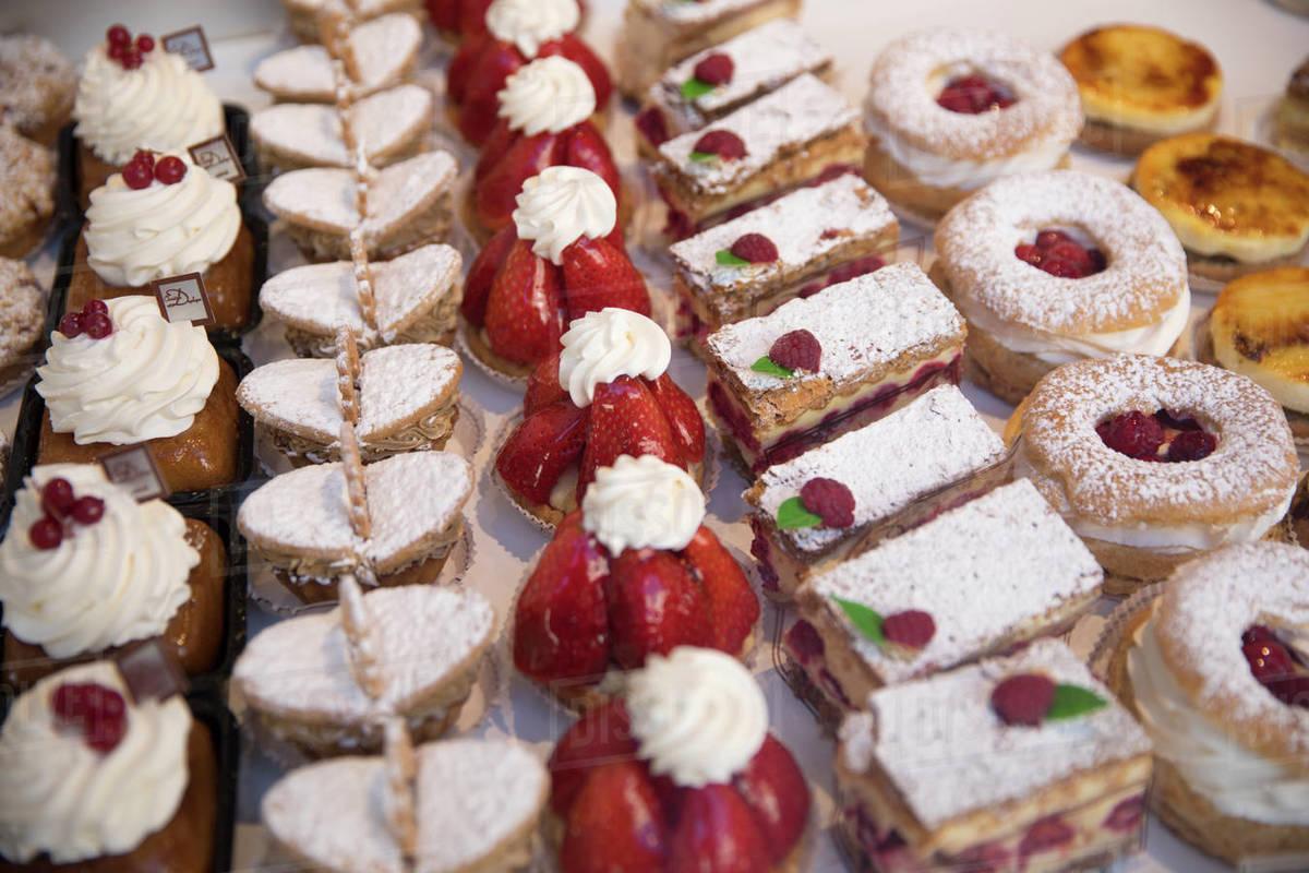 Tasty pastries in window of French patisserie shop, Arras, Pas-de-Calais, Hauts-de-France region