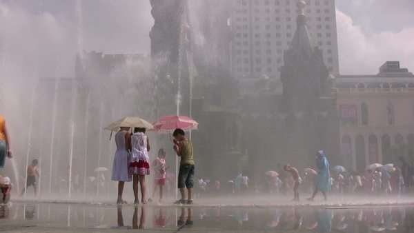 Children play with fountains in China Royalty-free stock video