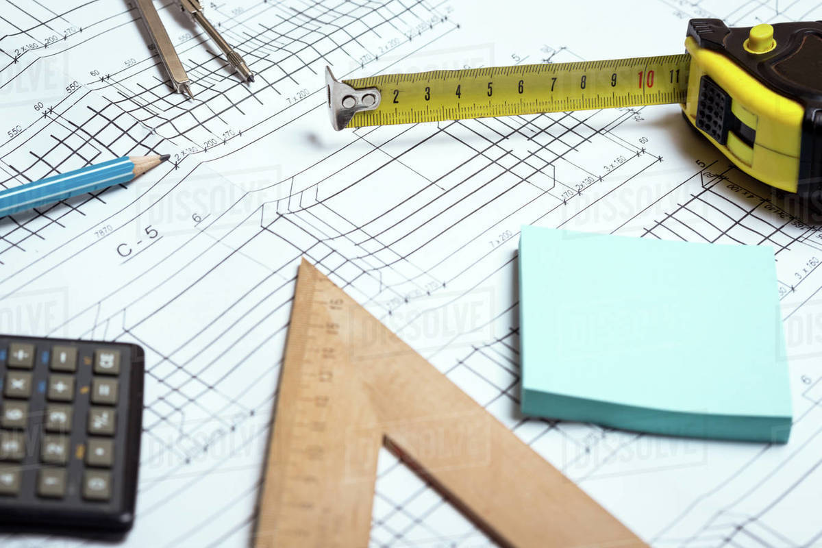 Engineering and design. drawing and calculator, tape measure, ruler on the table Royalty-free stock photo