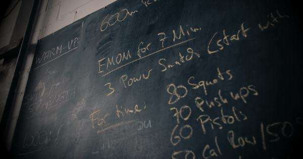 Blackboard with cross fit training plan written in chalk on wall Royalty-free stock video