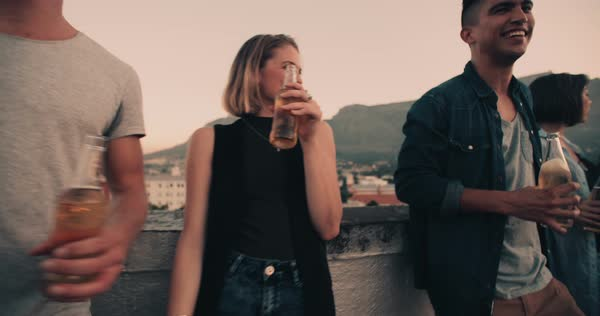 Group of hipster style young adult friends drinking on a summer rooftop party Royalty-free stock video