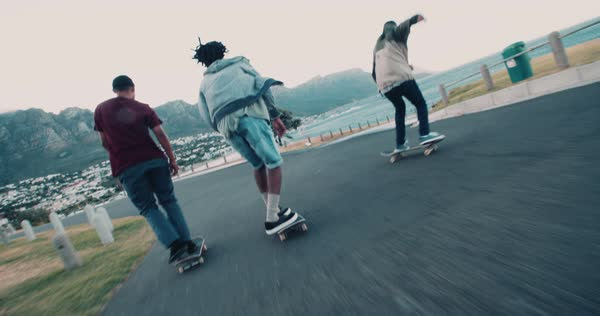 Group of skater friends skating down street along seaside Royalty-free stock video