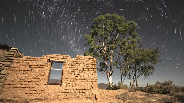Timelapse of stars and night sky with abandoned building Royalty-free stock video