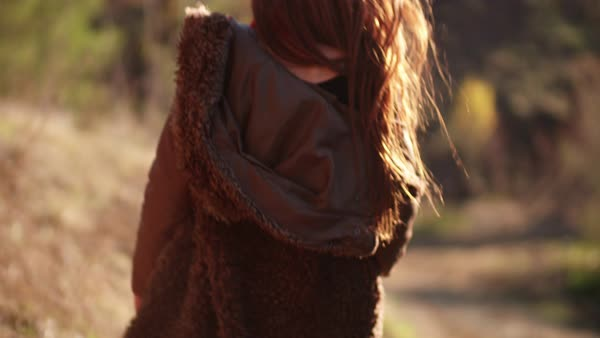 Close up of beautiful excited woman walking in the forest Royalty-free stock video