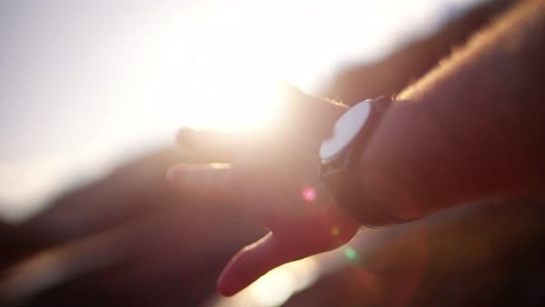 Close up of man's hand playing with rays of sun Royalty-free stock video