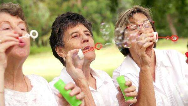 Senior lady's blowing bubbles Royalty-free stock video