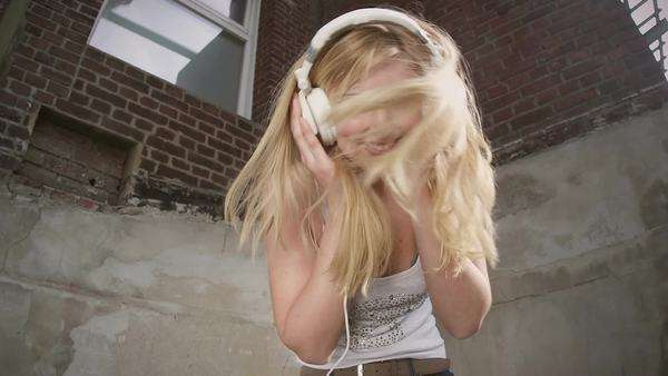 Young woman listening to music on headphones in slow motion Royalty-free stock video