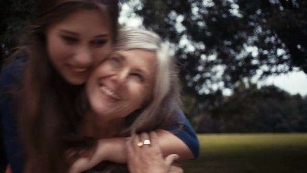 Daughter surprises mother with a loving hug from behind Royalty-free stock video