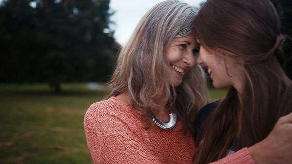 Mother and daughter put their heads together and share a moment Royalty-free stock video