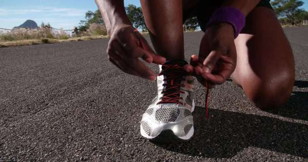 slow motion shot of an athlete tying his laces ready for some fitness training Royalty-free stock video