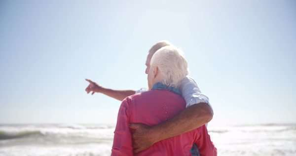 Senior couple enjoying their retirement together on the beach in slow motion Royalty-free stock video