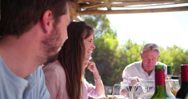 laughing Woman at a table during a family dinner with mature parents Royalty-free stock video