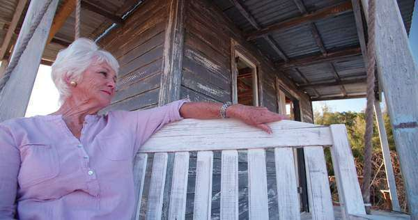Senior woman relaxing on front porch Royalty-free stock video