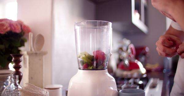 couple using their blender together to make a fresh healthy smoothie for breakfast Royalty-free stock video