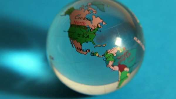Transparent sphere with world map on it spins in color light at loupe magnifies transparent sphere with world map on it royalty free stock video sciox Choice Image