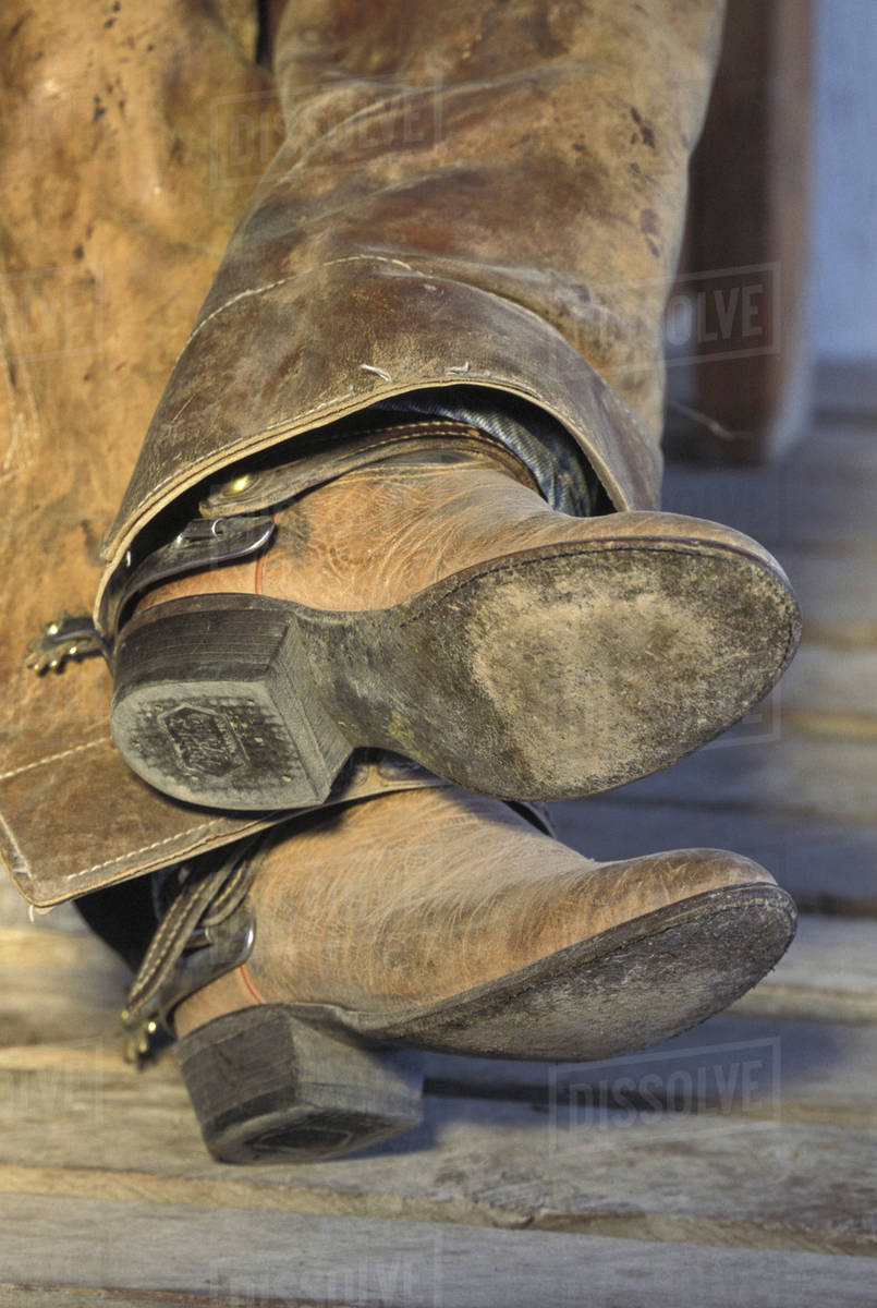USA, Montana Cowboy boots on sleeping cowboy stock photo