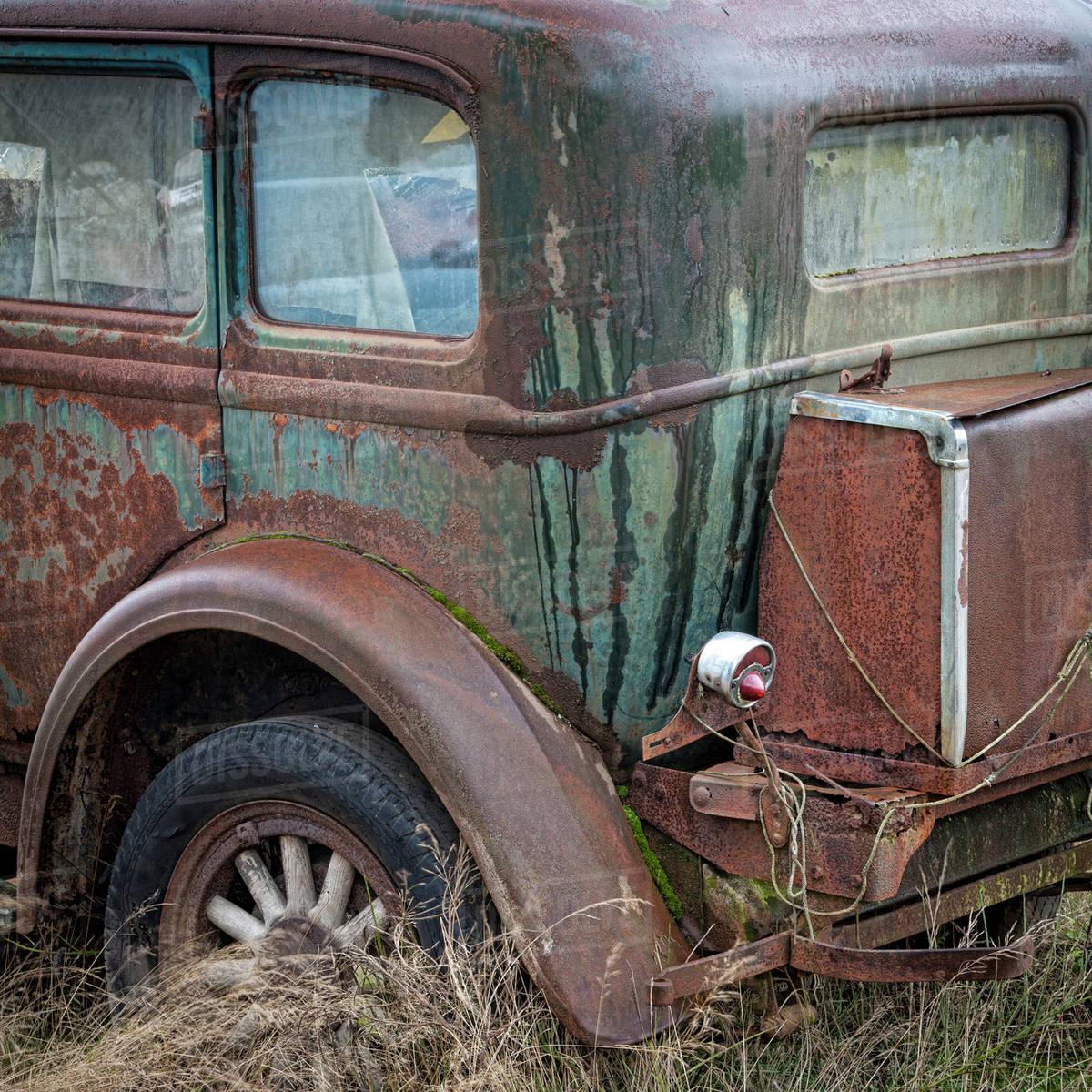 USA, Washington, Belfair. Rusted old car in junkyard. - Stock Photo ...