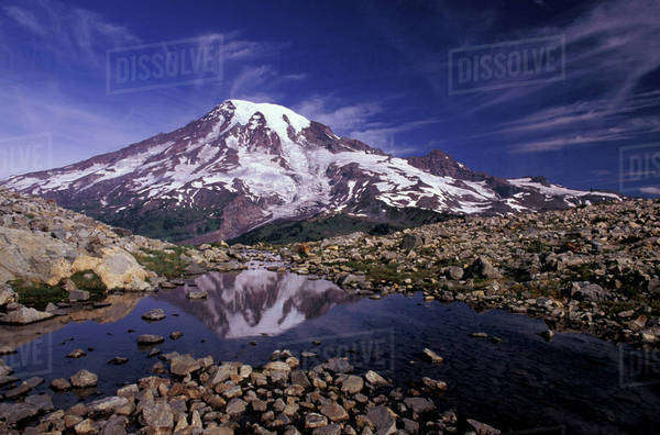 N.A., USA, Washington, Mt. Rainier National Park, Mt. Rainier Reflected in glacial stream, Grinnel Glacier, Tatoosh Range Royalty-free stock photo