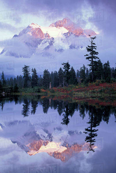 USA, WA, Heather Meadows RA. Mount Shuksan shrouded in clouds and reflected in Picture Lake. Royalty-free stock photo
