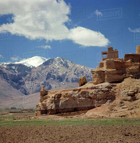 Afghanistan, Bamian Valley. The ruins of a lookout languish above pastures in the Bamian Valley, a World Heritage Site, in Afghanistan. Royalty-free stock photo