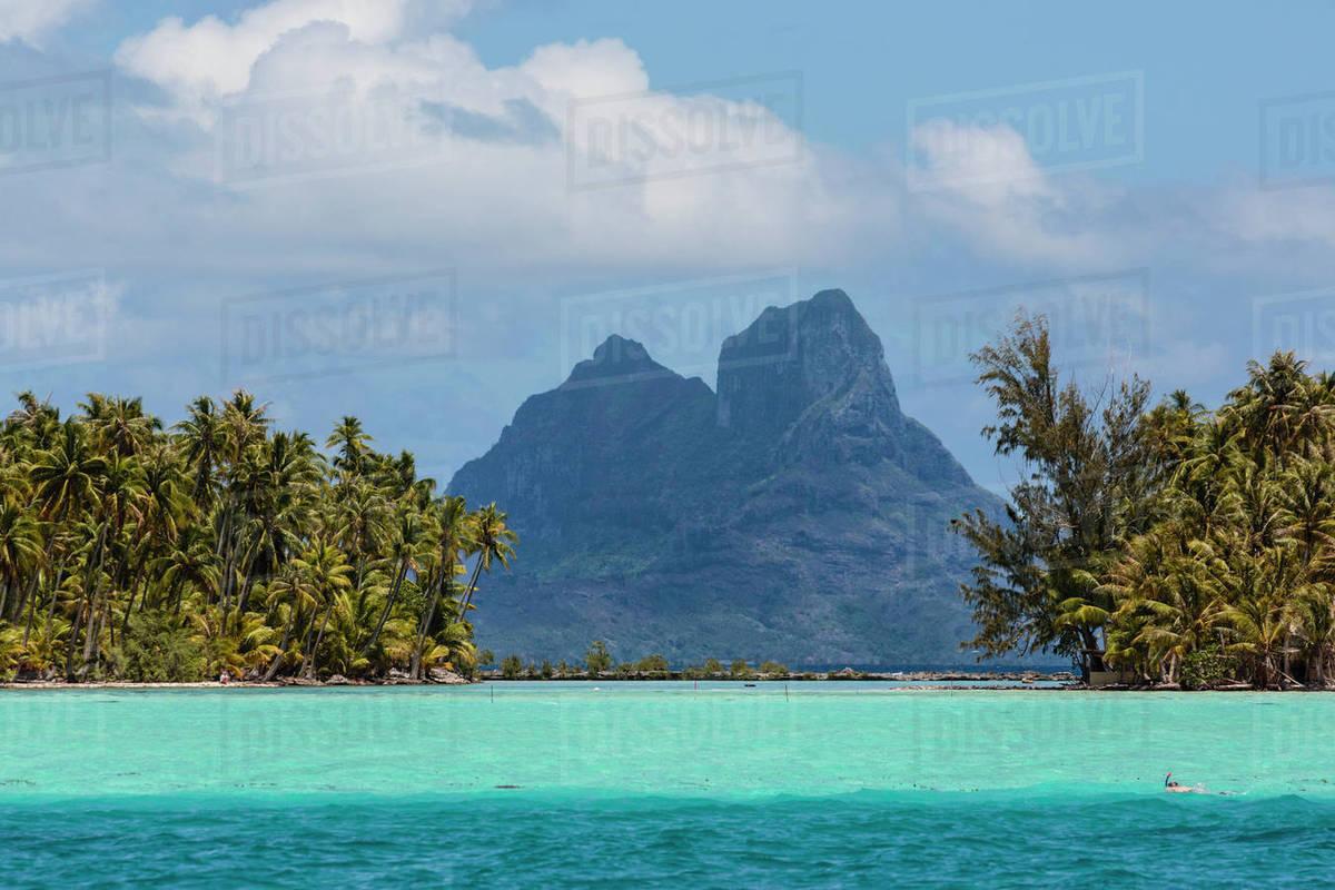 Pacific Ocean, French Polynesia, Society Islands, Leeward Islands, Bora  Bora  View of extinct volcano and peaks of Mount Otemanu and Mount Pahia