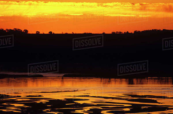 Sun rises over the Missouri River from Niobrara State Park in Nebraska Rights-managed stock photo
