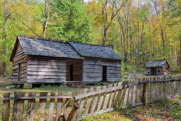 Tennessee, Great Smoky Mountains National Park, Roaring Fork Motor Nature Trail, Ephraim and Minerva Bales farm, dog-trot style farmhouse, built circa 1890, with corn crib Rights-managed stock photo