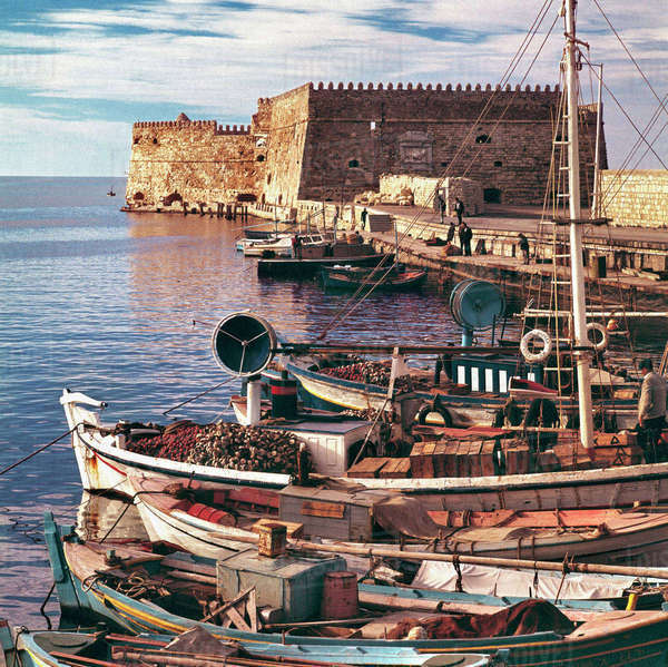 Europe, Greece, Iraklion. Fishing boats are moored at the old port near the Rossa al Mare at Iraklion, Crete, Greece. Rights-managed stock photo