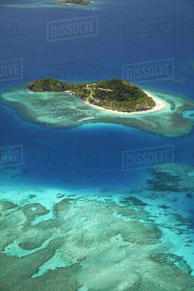 Matamanoa Island and coral reef, Mamanuca Islands, Fiji, South Pacific, aerial Rights-managed stock photo