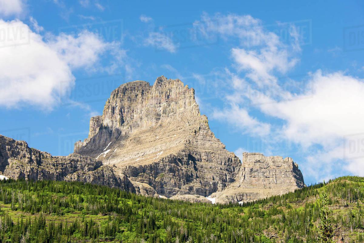 Glacier National Park  Iceberg Lake Trail vista dominated by Mt Wilbur  stock photo