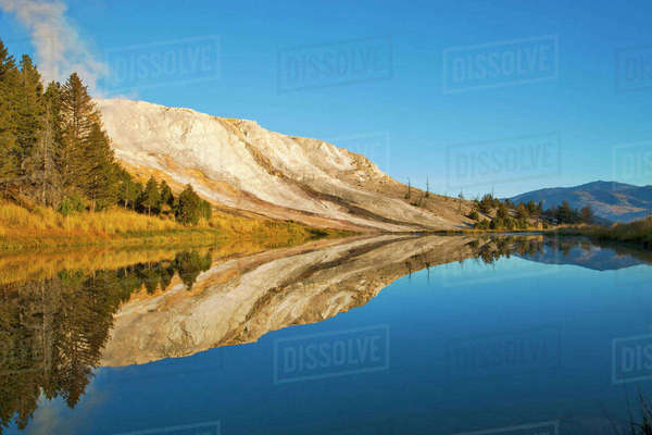 Canary Springs Terrace reflects in small pond at the Mammoth Hot Springs area in Yellowstone National Park in Wyoming Rights-managed stock photo