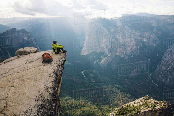 Man sitting at top of mountain, overlooking Yosemite National Park, California, USA Royalty-free stock photo