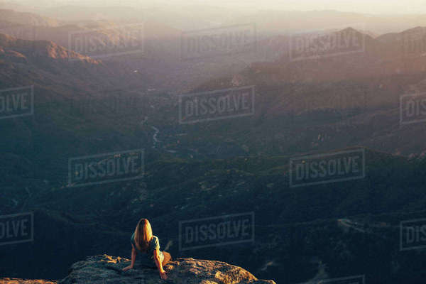 Woman sitting on edge of Moro Rock, Sequoia National Park, California, USA Royalty-free stock photo