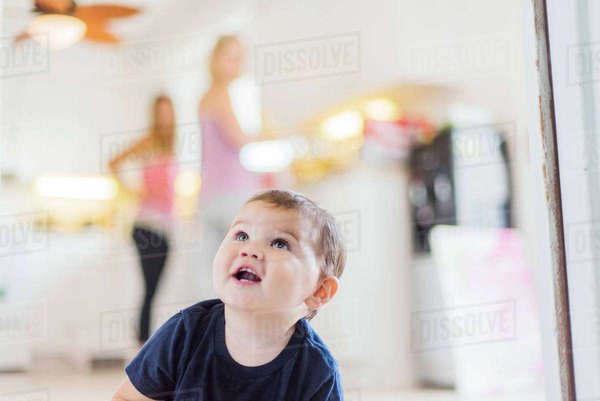 Toddler looking up, people in background Royalty-free stock photo