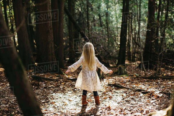 Blond haired girl in forest Royalty-free stock photo