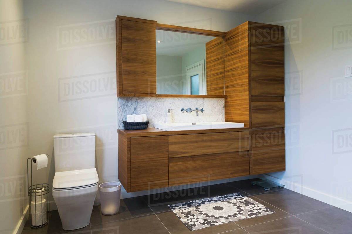 White High Back Flush Toilet And American Walnut Wood Vanity With
