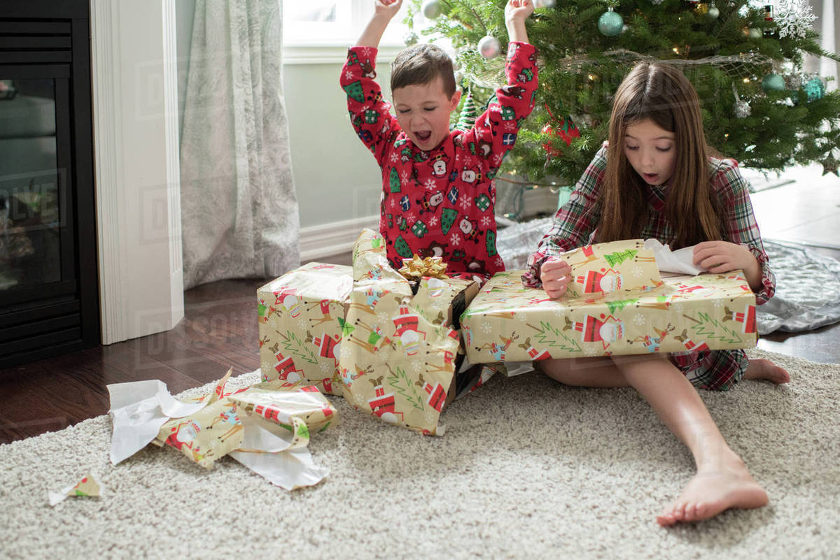 Christmas Presents For Brother.Brother And Sister Opening Christmas Presents Stock Photo