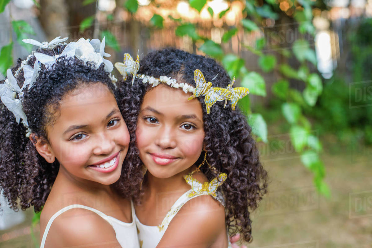 Portrait of two girls, wearing butterflies in hair Royalty-free stock photo