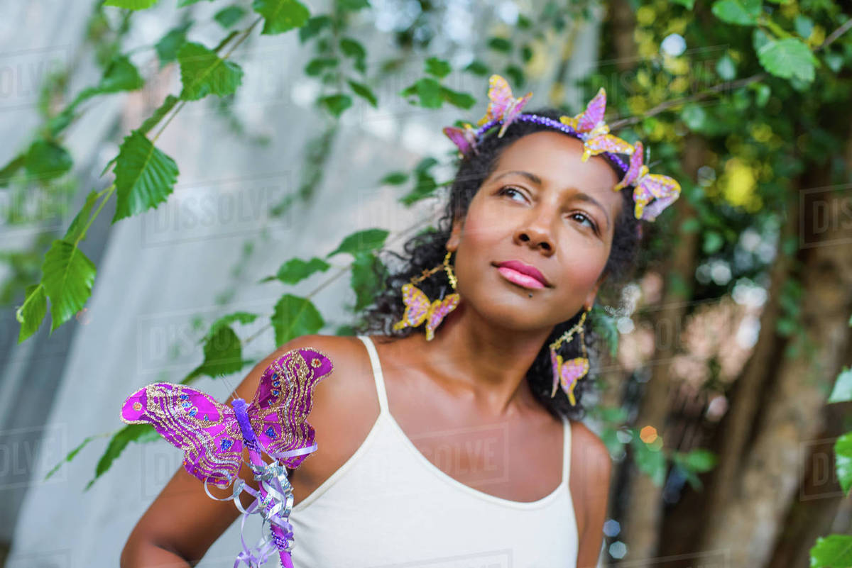 Portrait of mature woman wearing butterflies in her hair Royalty-free stock photo