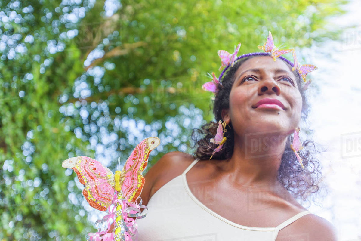 Portrait of mature woman dressed as fairy, outdoors Royalty-free stock photo