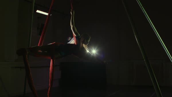 Young woman doing exercises on aerial silk Royalty-free stock video