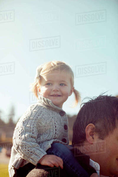 Female toddler on father's shoulders Royalty-free stock photo