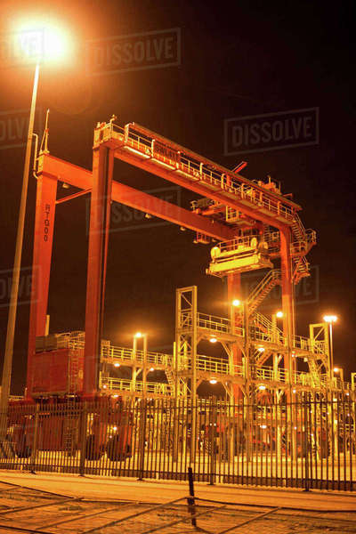 Cranes and ladders in shipyard at night Royalty-free stock photo